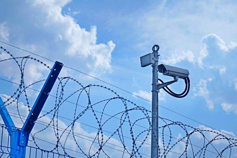 Fence, razor wire and video camera.