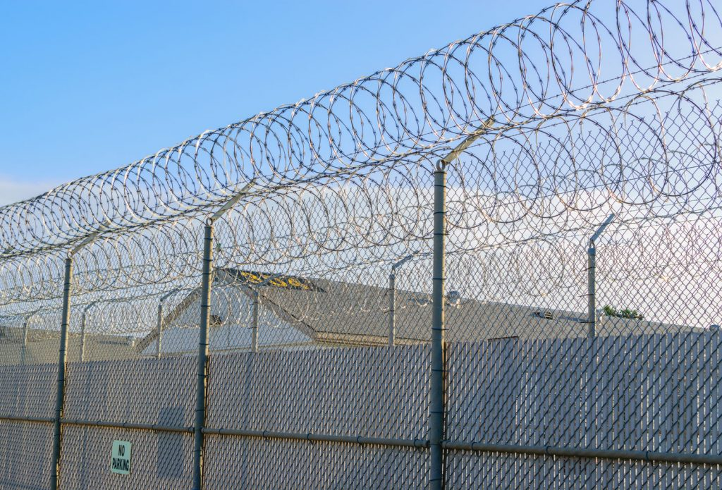 Double Fence Line with Razor Wire